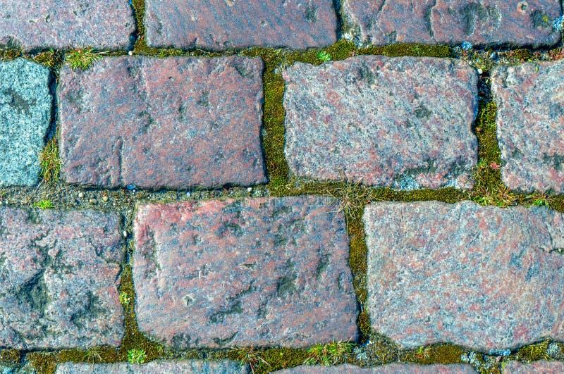 Vieux trottoir en pierre comme fond naturel images stock