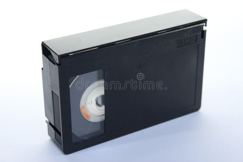 Vieux type VHS-c de cassette de bande sur le blanc photographie stock