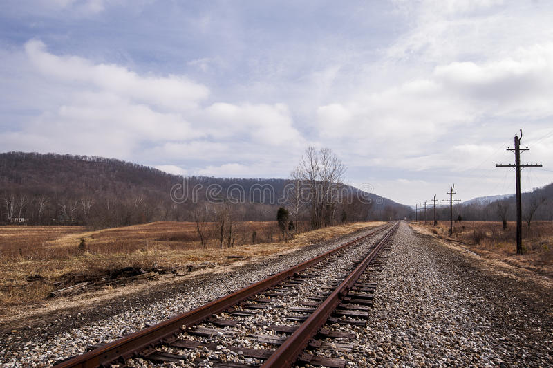 Abandoned Railroad - Track View on Cloudy Afternoon. A view of an abandoned railroad in southern Ohio on a cloudy winter afternoon stock images