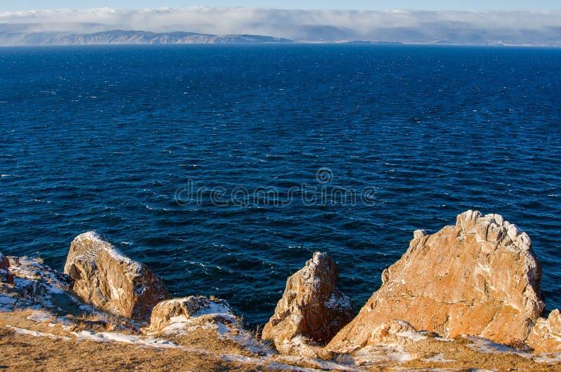 View above big beautiful lake and mountain Three brothers in winter, Baikal lake, Russia. Siberia royalty free stock image