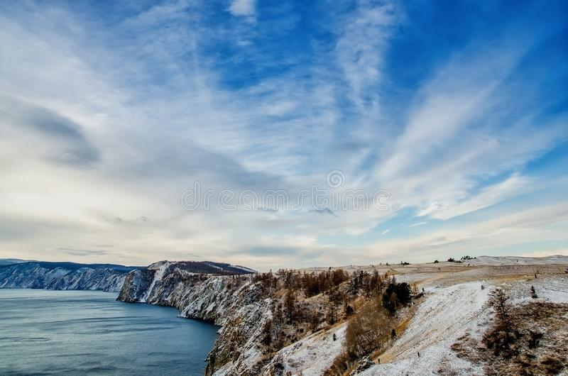View above big beautiful lake and mountain in winter, Baikal lake, Russia royalty free stock photography