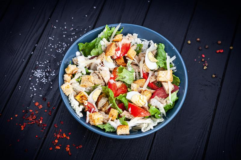 View from above Caesar salad with chicken, lettuce, parmesan cheese, tomato. Copy space for design. Healthy food bowl. Dieting. royalty free stock photos