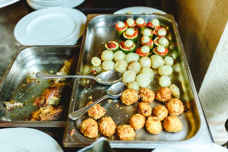 View from above of catering tray with potatoes and meat medallions stock images