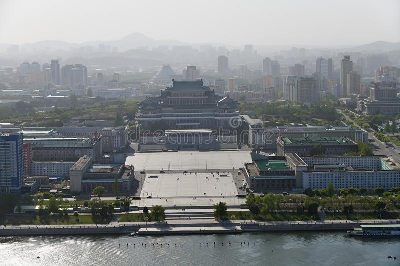 Pyongyang, North-Korea. Kim Il Sung square. View from above on the central square of Kim Il Sung at sunset time. Great People`s Study House with of portraits of stock image
