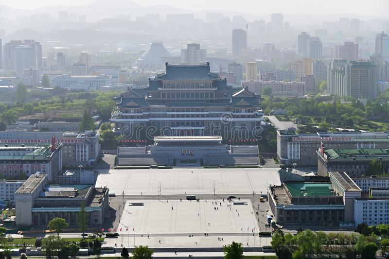 Pyongyang, North-Korea. Kim Il Sung square. View from above on the central square of Kim Il Sung at sunset time. Great People`s Study House with of portraits of stock photos