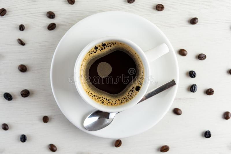 View from above of a delicious and tasty cup of freshly made coffee with coffee. Detail of View from above of a delicious and tasty cup of freshly made coffee royalty free stock photography