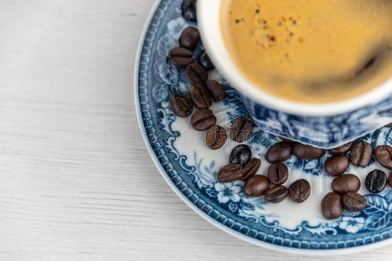 View from above of a delicious and tasty old and rustic cup of freshly made coffee with coffee beans stock photos