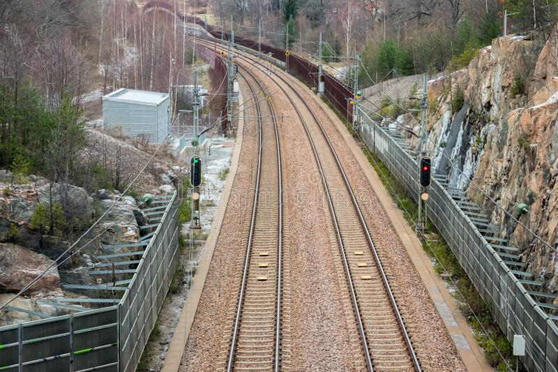 View from above of double railroad tracks in a mountain and forest environment. royalty free stock photo