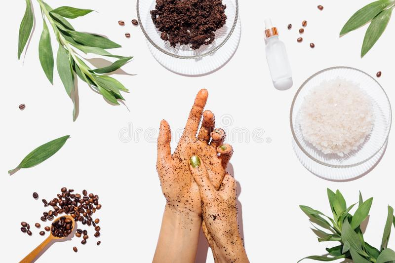 View from above female's hands applying homemade coffee scrub stock photography