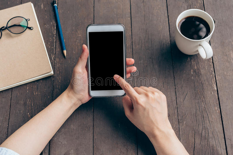 View above hand woman holding phone in coffee shop royalty free stock photos