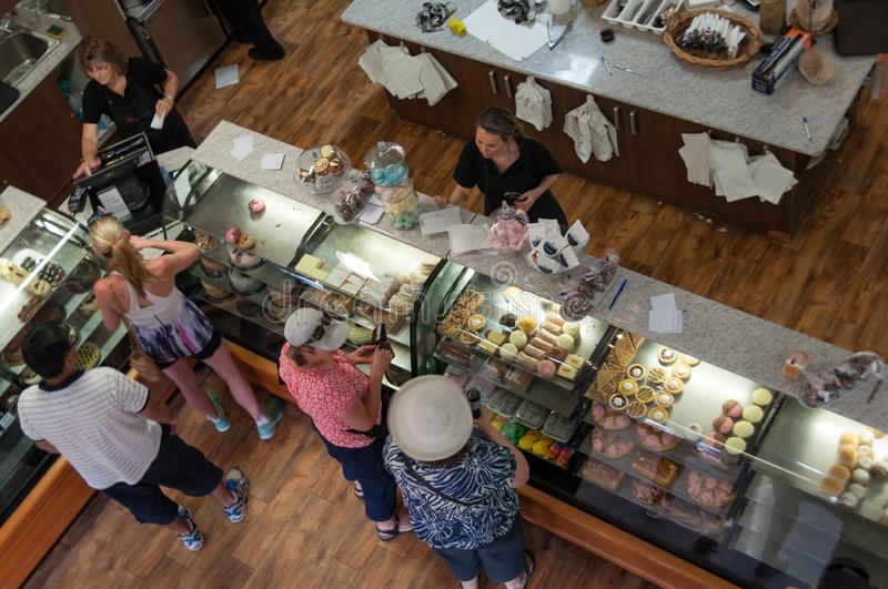 View from above on interior of bakery, coffee shop with customers making orders stock photos