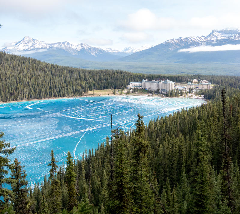 View above the lake louise. Canada, Rocky Mountains: view point above lake Louise with view at the frozen lake and also the hotel Fairmont Chateau stock photography