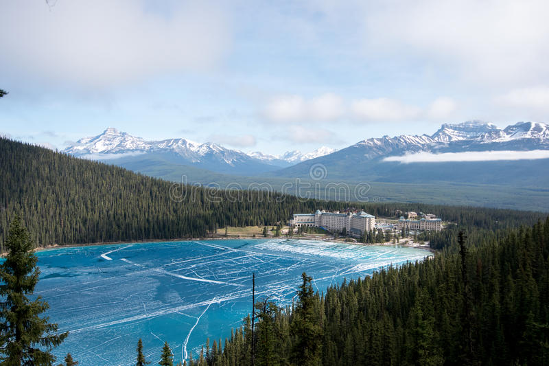 View above the lake louise. Canada, Rocky Mountains: view point above lake Louise with view at the frozen lake and also the hotel Fairmont Chateau royalty free stock image