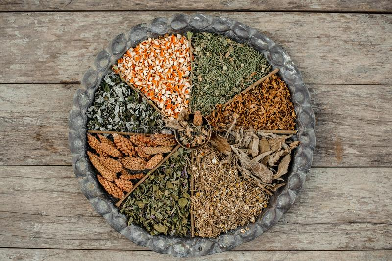 View from above large round dish divided into sections with dry herbs stock photos