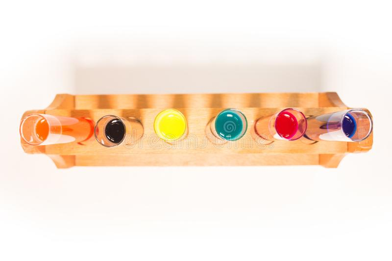 View from above of many test tubes filled with fluids of various colors. View from above of colorful test tubes filled with fluids royalty free stock images