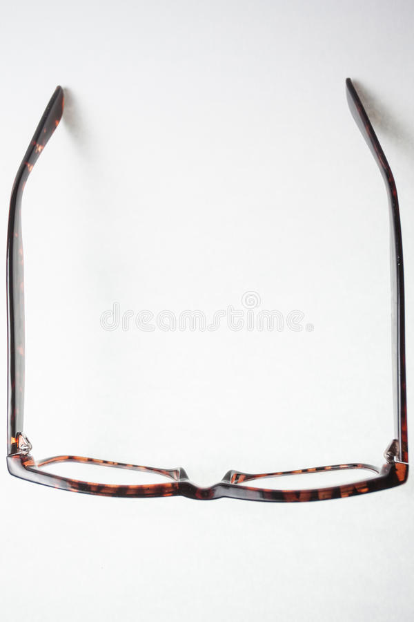 View from above on a pair of trendy brown eyeglasses royalty free stock images