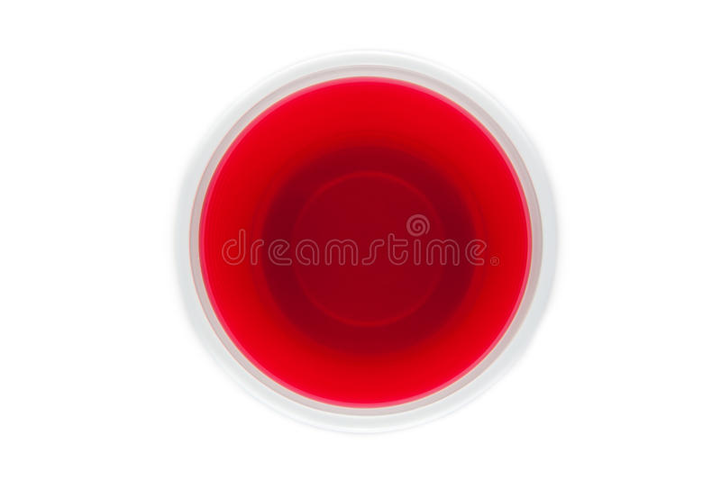 View from above of a plastic cup with red drink royalty free stock photos