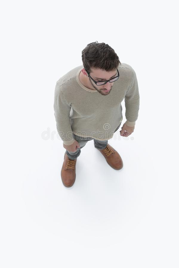 View from above. serious young man looking forward stock photography
