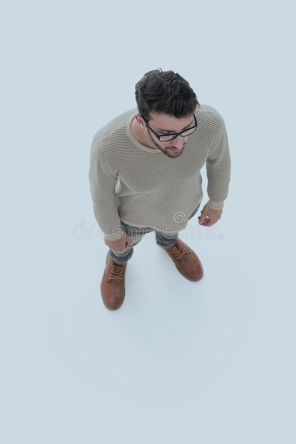 View from above. serious young man looking forward stock photo