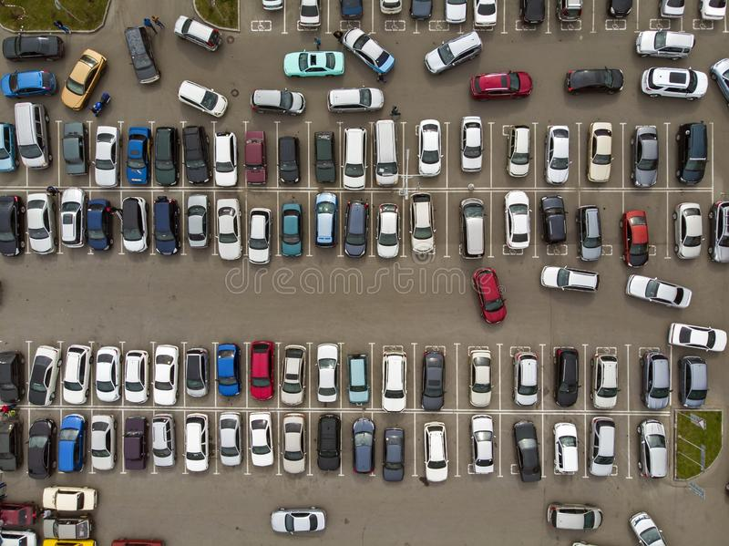 A view from above to the lines of parked cars. Heavy traffic in the parking lot. Searching for spaces in the busy car park. stock photos