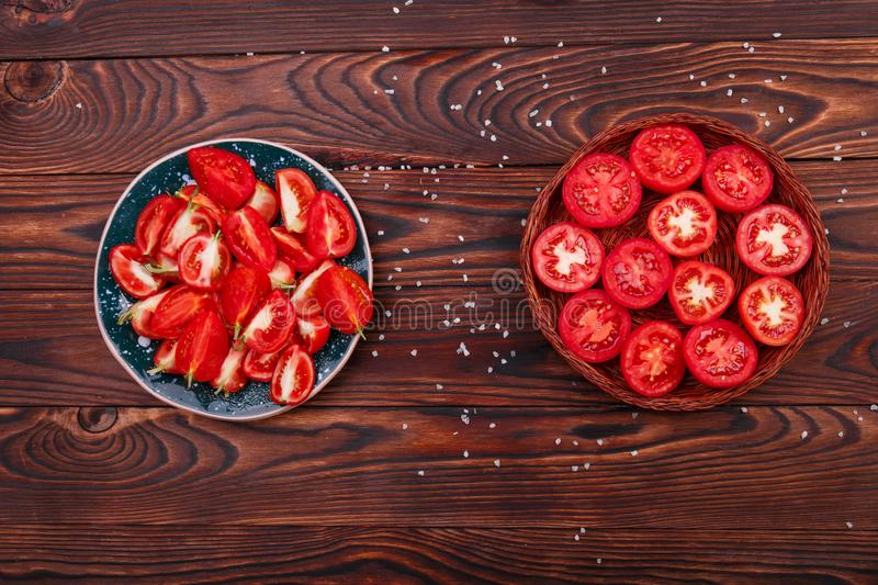 Top view of bowl with sliced tomatoes on a table background. Healthy cooking concept. royalty free stock images