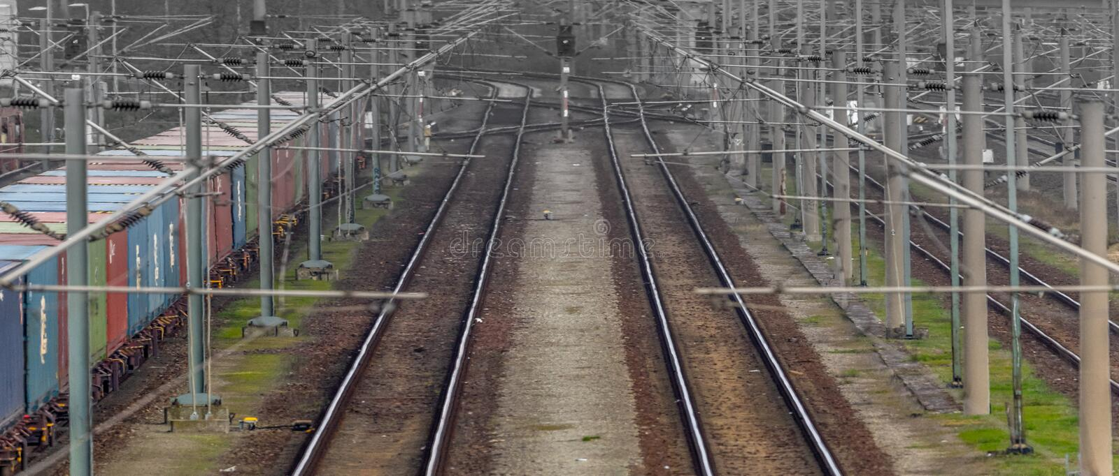 View from above on two railway tracks which vanish in the distance. Abstract royalty free stock photo