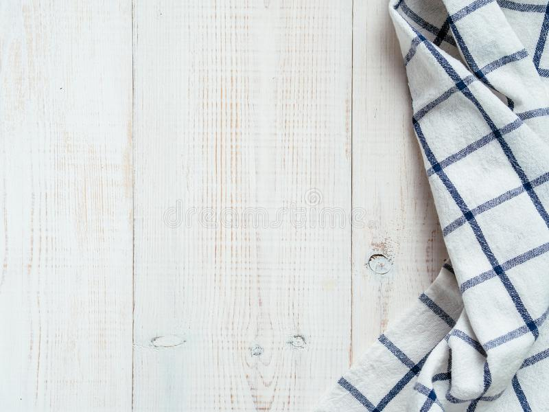Blue tablecloth on white wooden table royalty free stock image