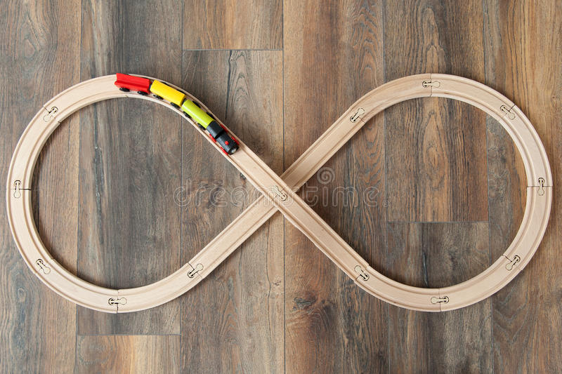 View from above wooden train and railway for kids on wooden floor royalty free stock image