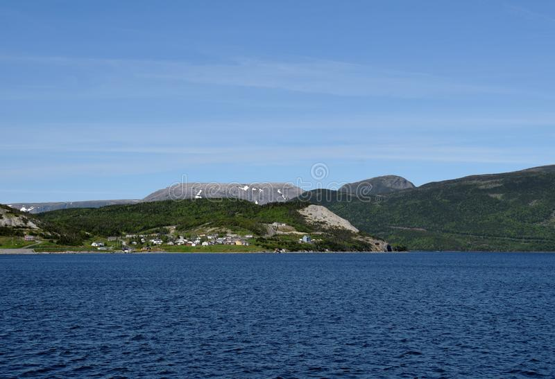 View across the Bonne Bay towards Norris Point. And the Gros Mornew mountain, scenery along the Viking Trail in the Gros Morne National Park, Newfoundland and stock images