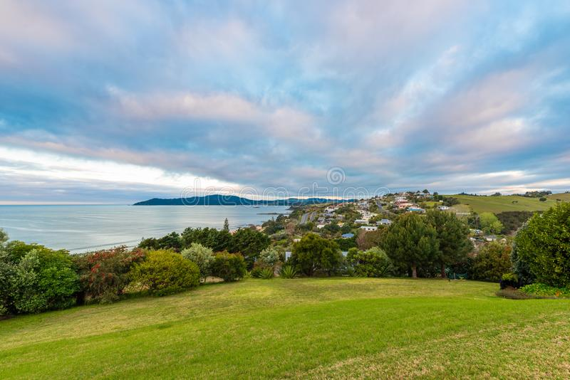 View across Cable Bay in Mangonui New Zealand. At sunset with colorful skies royalty free stock photos