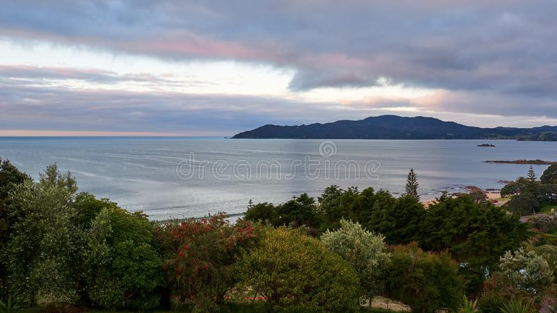 View across Cable Bay in Mangonui New Zealand. At sunset with colorful skies stock images