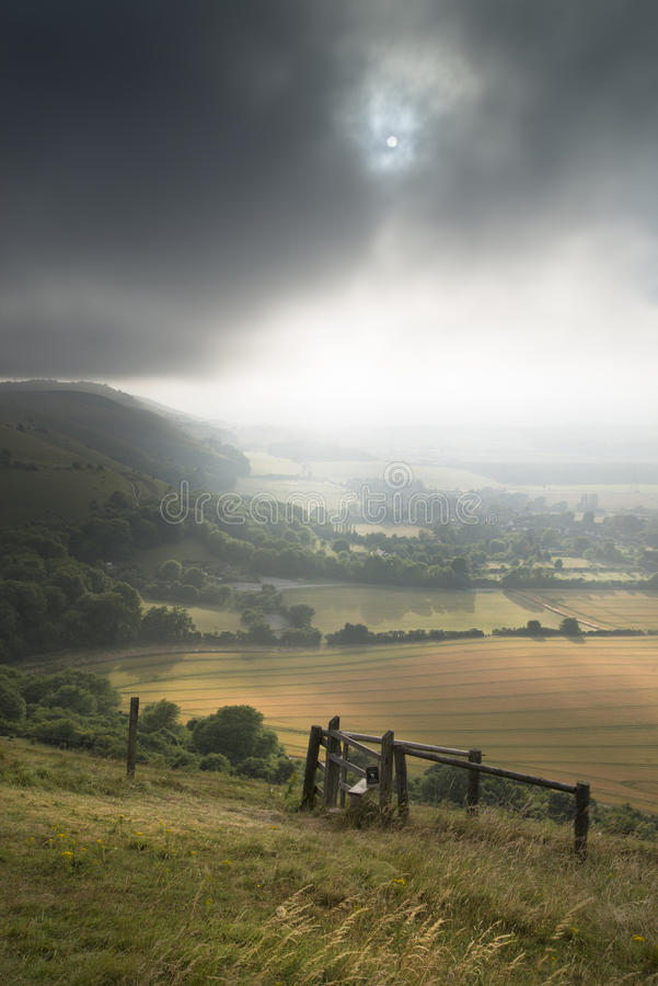 View across English countryside landscape during late Summer eve. English countryside landscape during late Summer afternoon with dramatic sky and lighting stock photos