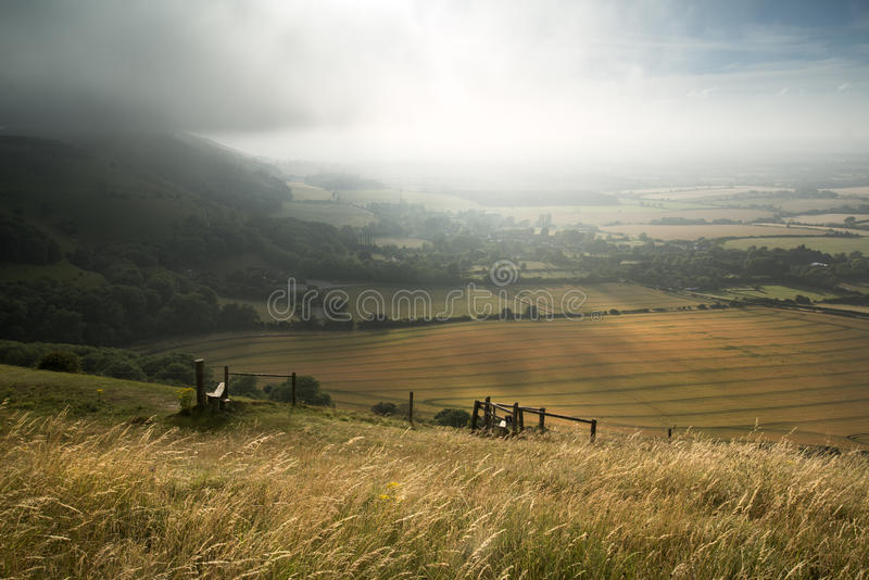 View across English countryside landscape during late Summer eve. English countryside landscape during late Summer afternoon with dramatic sky and lighting royalty free stock photos