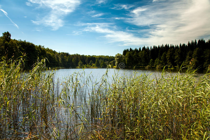View across a lake at Liepnitzsee. Empty lake at Liepnitzsee Brandenburg Germany on a sunny afternoon stock images