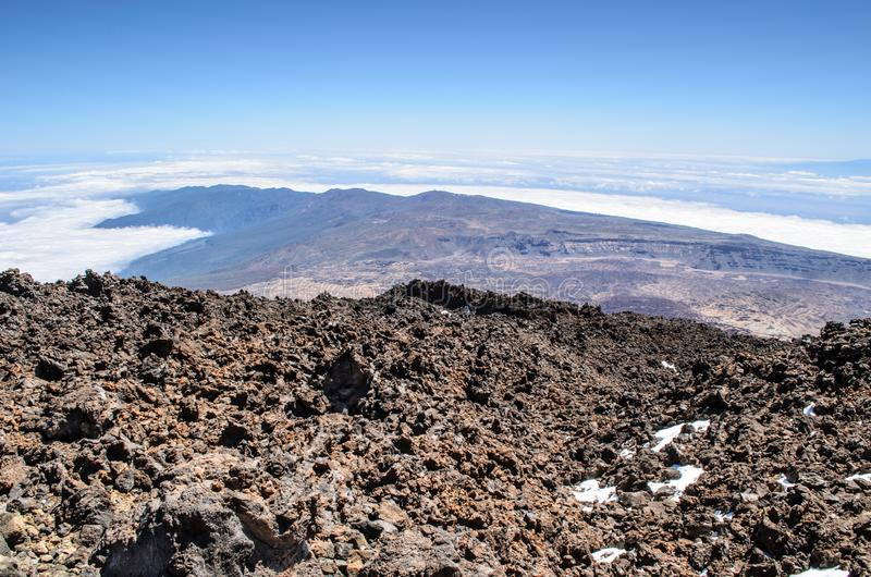 A view across lava field to Atlantic ocean with La Gomera Island behind from the top of volcano Teide, Teide National Park, stock image