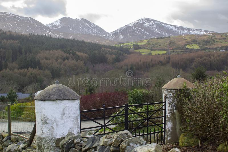 A view across one of the many snow topped hills and valleys of the Mourne Mountains in County down in Northern Ireland on a dull m royalty free stock photos