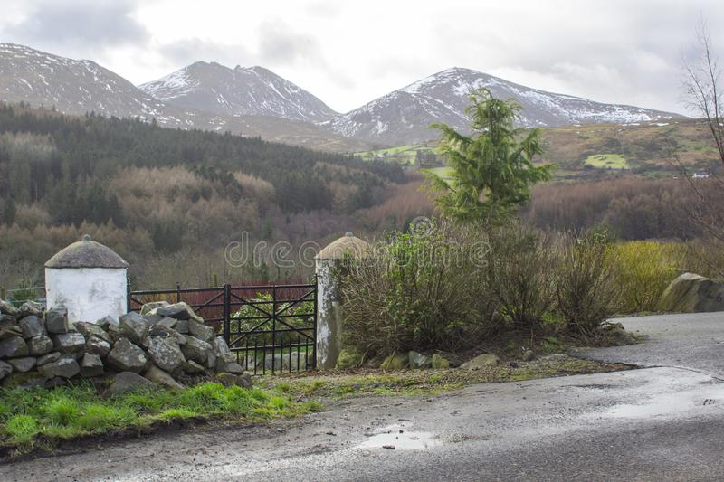 A view across one of the many snow topped hills and valleys of the Mourne Mountains in County down in Northern Ireland on a dull m. A view across one of the many stock photo