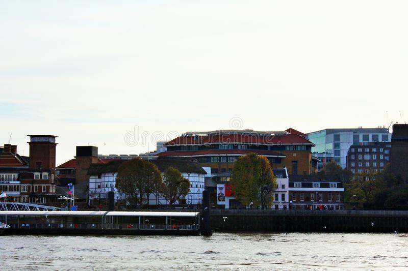 View across the River Thames of the Globe Theatre in London. The Globe Theatre on the South Bank across the Thames in London royalty free stock photography