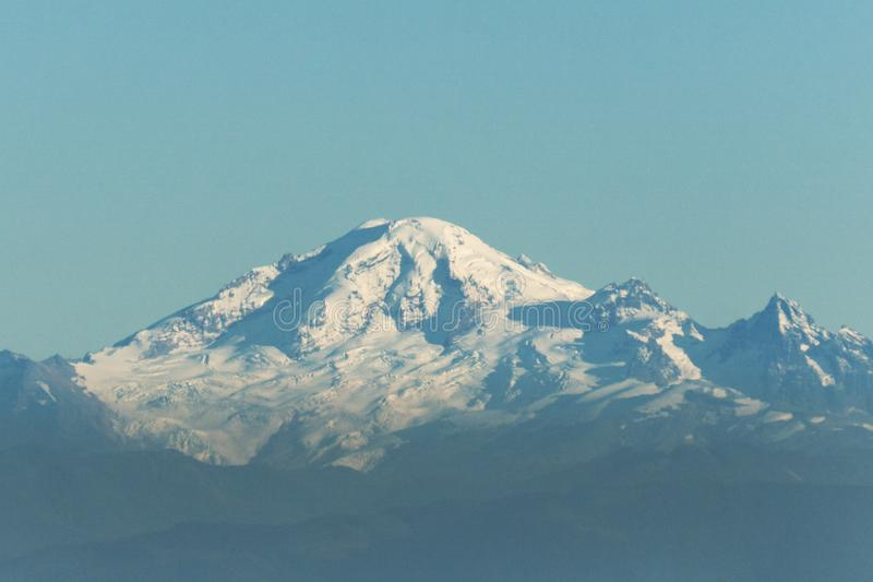 View of an active volcano Mount Baker in the North Cascades Washington USA.  stock images