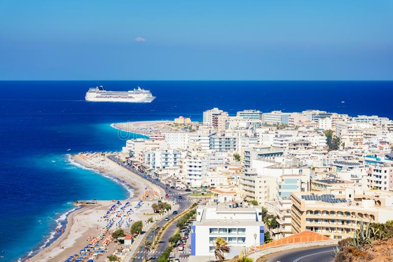 View of Aegean coast of City of Rhodes and cruise ship Rhodes, stock photo