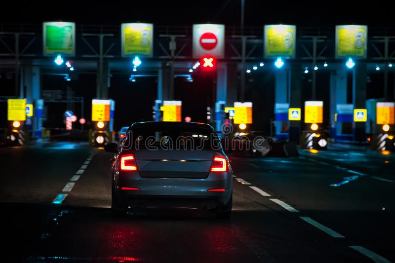 View on an ahead moving car to a checkpoint of multi-lane toll motorway. stock photography