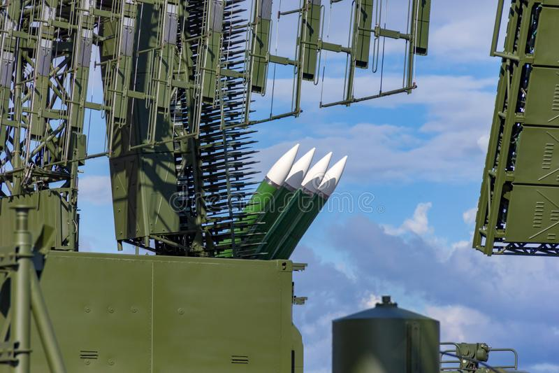Air defense antenna and rockets looking into a sky stock photo