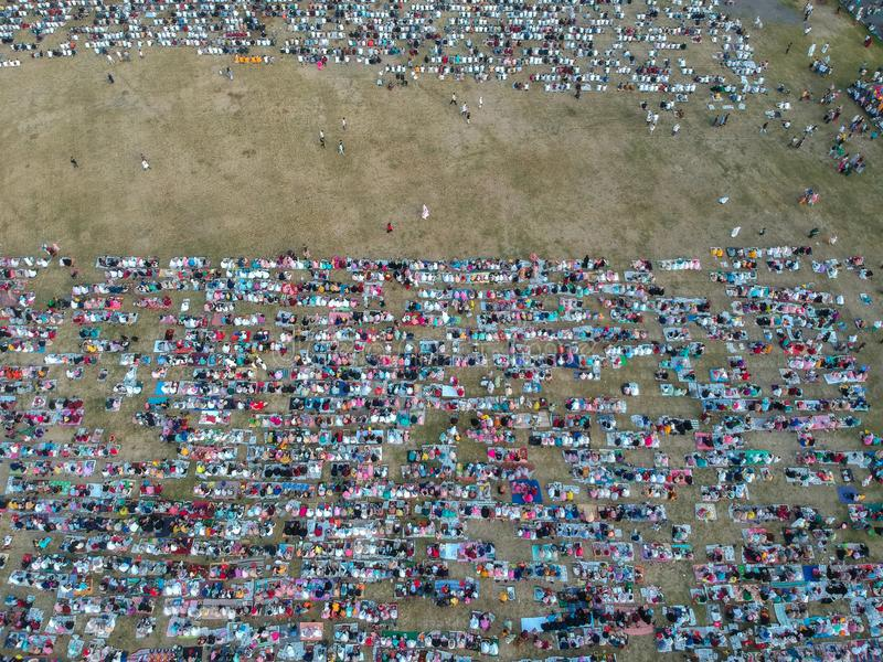 DENPASAR, BALI/INDONESIA-JUNE 05 2019: The view from the air of the Eid al-Fitr prayer in 2019 at Puputan Renon field. Eid prayers. The view from the air of the stock images