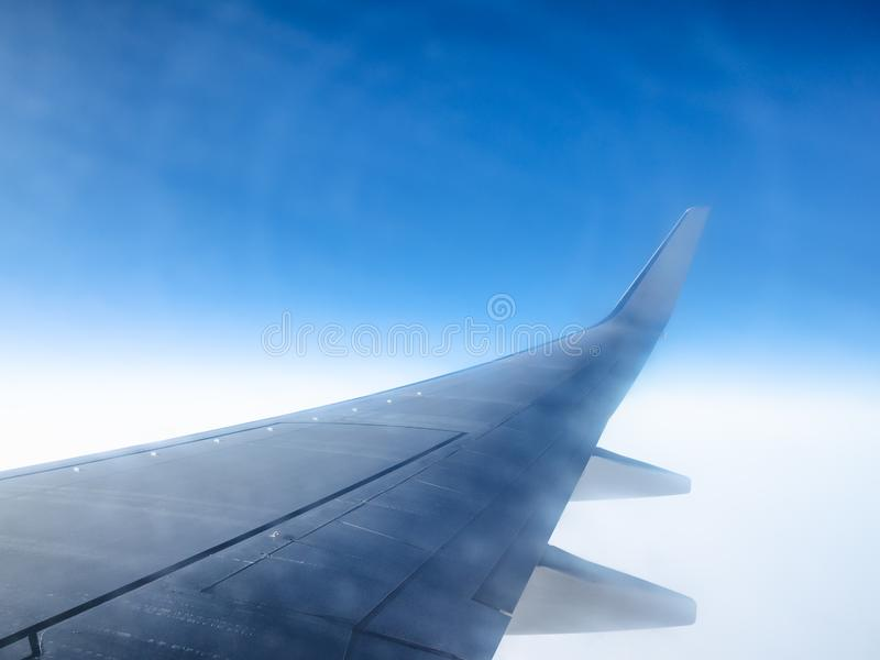 View of aircraft wing and halo phenomena. In blue sky during flight through porthole stock images