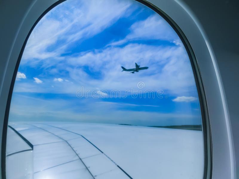 View from an airplane on a blue sky and white clouds. Flying on the airplane. royalty free stock images