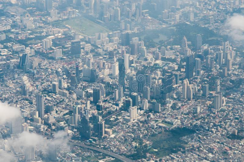 View from airplane cityscape Bangkok skyline, Thailand. Bangkok is metropolis and favorite of tourists live at between modern stock photos