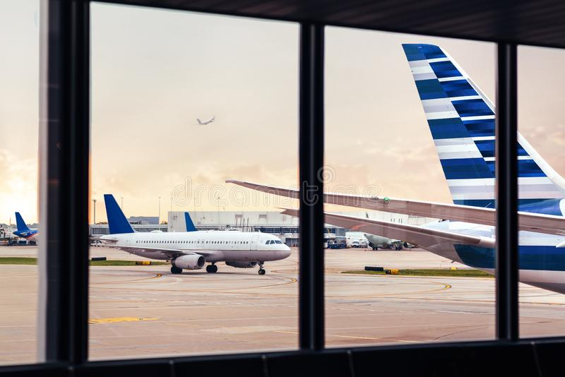 View of airplane fuselage tail through window at airport royalty free stock images