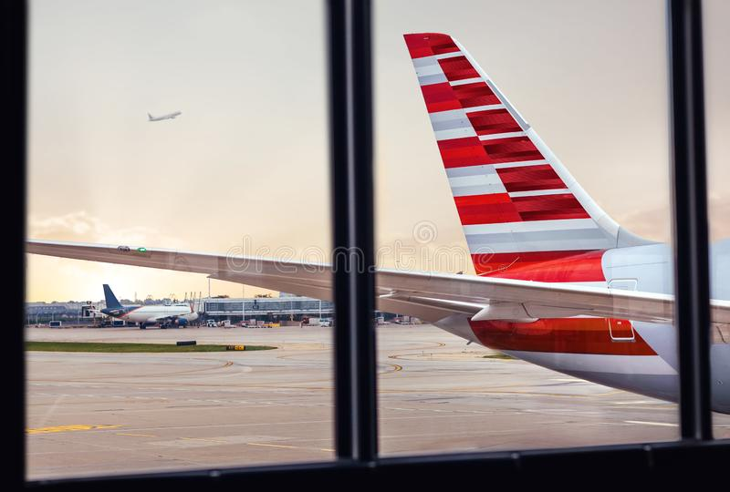 View of airplane fuselage tail through window at airport stock photography