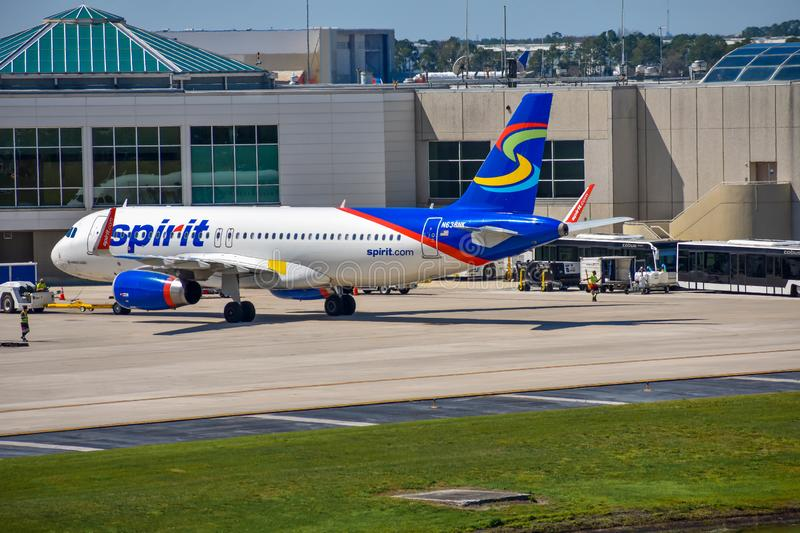 View of airplane from Spirit Airlines NK  at the gate in Orlando International Airport MCO  1. Orlando, Florida.  March 03, 2019. View of airplane from Spirit stock image