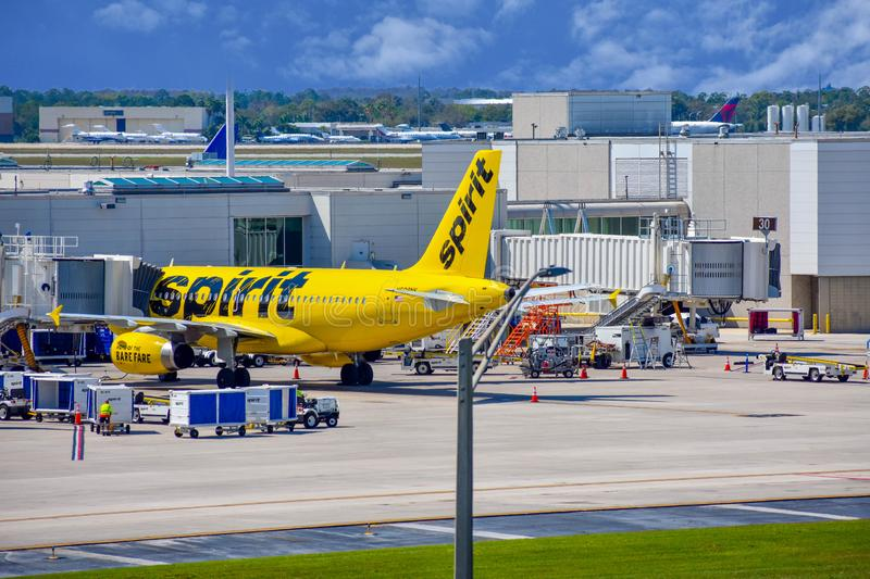View of airplane from Spirit Airlines NK  at the gate in Orlando International Airport MCO   1. Orlando, Florida.  March 02, 2019. View of airplane from Spirit stock photos